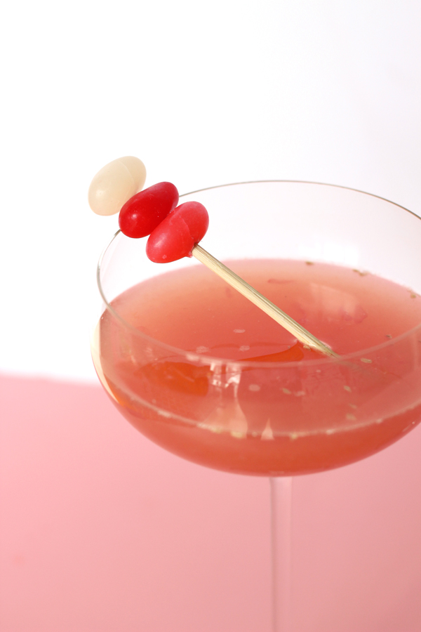 Valentine Citrus Amaretto Sour Cocktail & jelly bean stir stick
