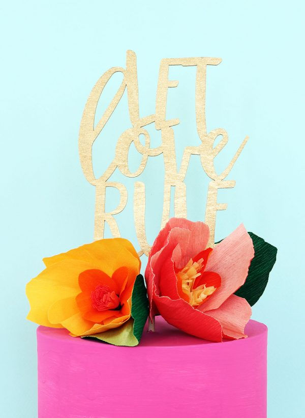 Let love rule gold laser cut wedding cake topper by The Sweet Escape