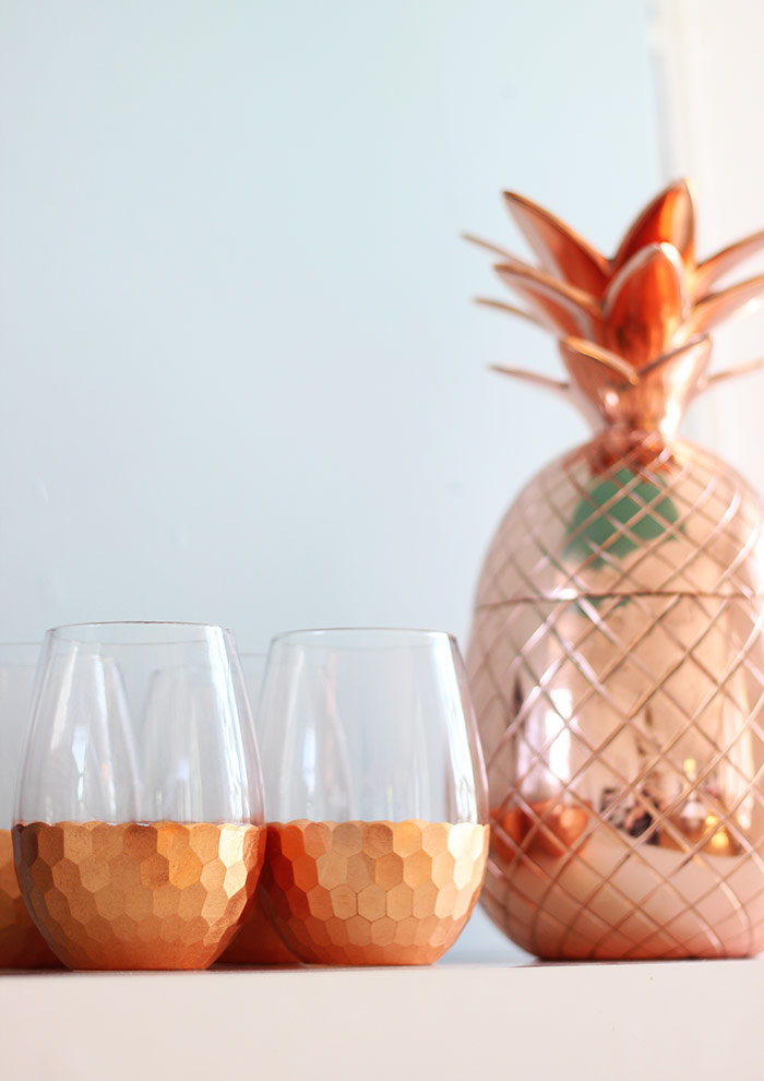 Copper pineapple and wine glasses bar accessories