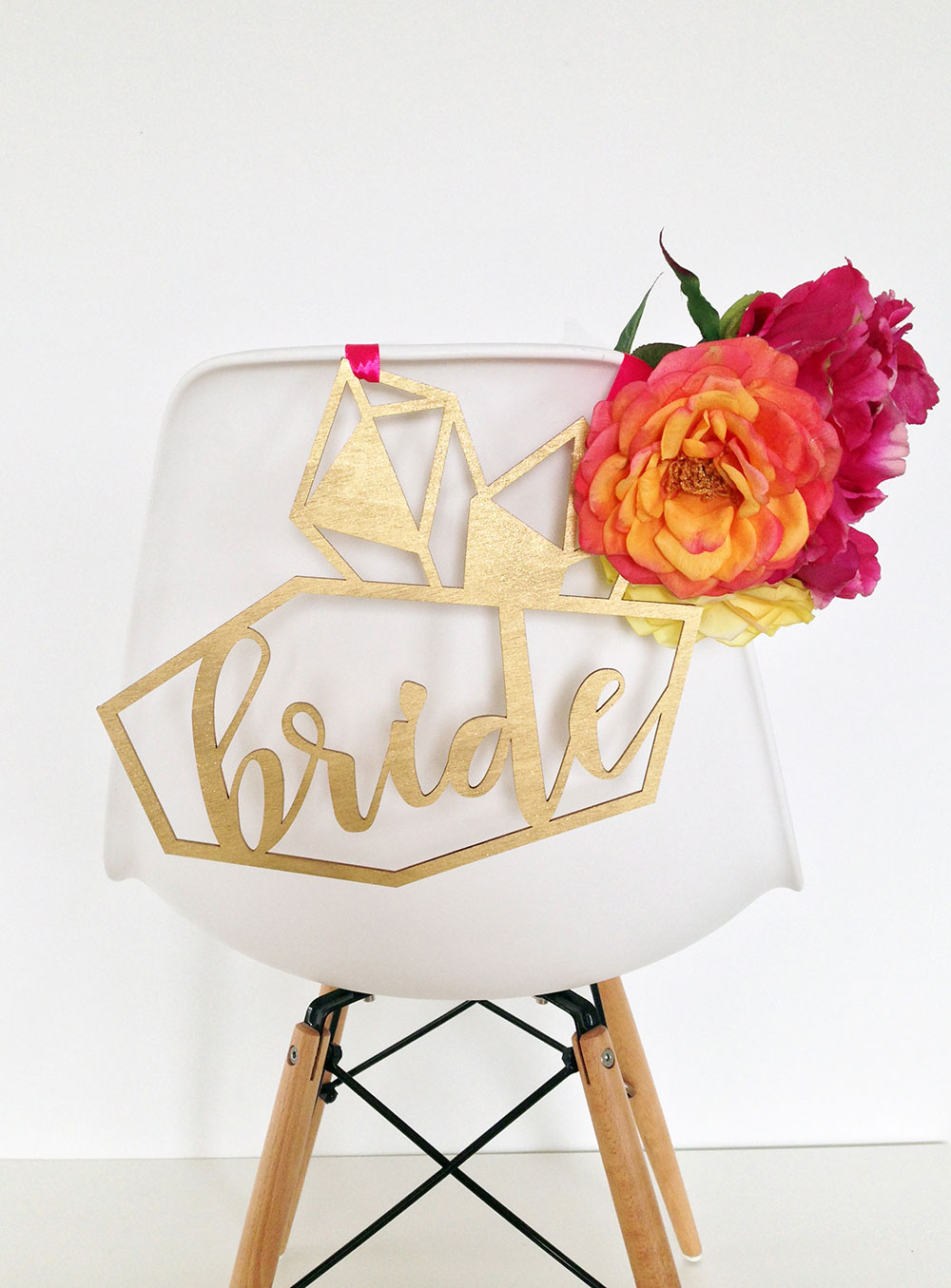 Custom designed laser cut wedding chair hangers by Sweet Escape Occasions