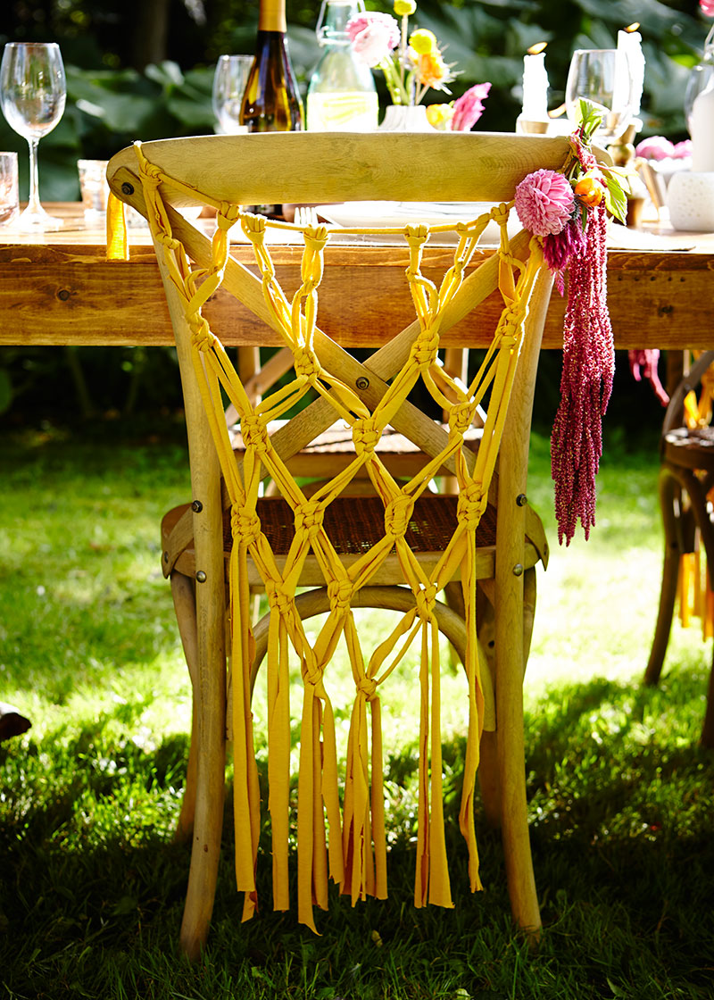 Outdoor summer dinner party macrame chair hanging - The Sweet Escape